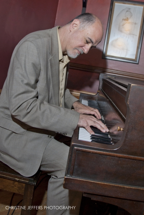 kahn playing piano two